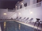Casa en la Colina (House on the hill) - Poolside and lower terrace in the evening