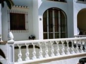 Downstairs Apartment - Torrevieja - Front view of apartment showing enclosed sun-terrace with barbeque